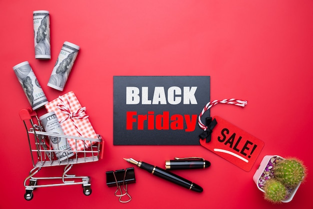 Black friday sale text on a red and black tag with gift box