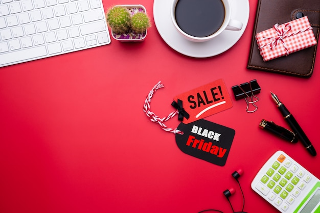 Black friday sale text on a red and black tag