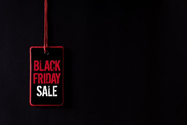 Black friday sale text on a red and black tag.