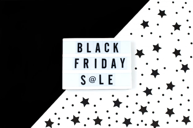 Black friday sale text on white lightbox and black stars banner background