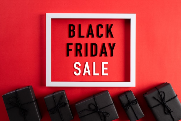 Black friday sale text on white picture frame with black gift box