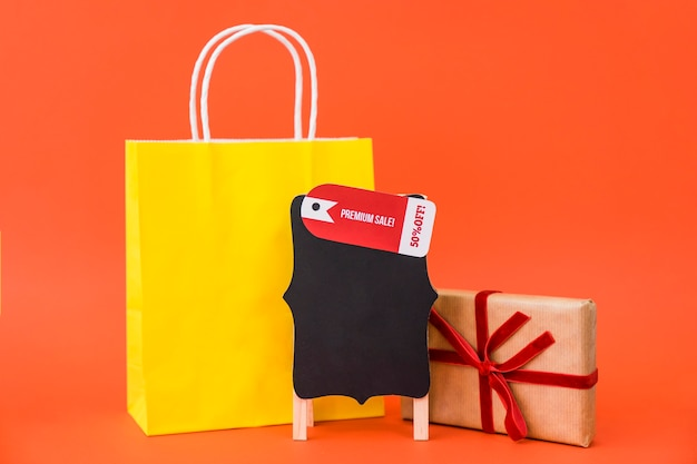 Black friday sales concept with bag and gift box