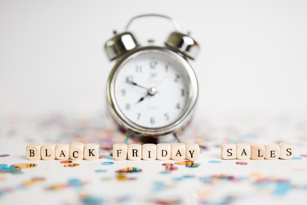 Black friday sales inscription on cubes with clock