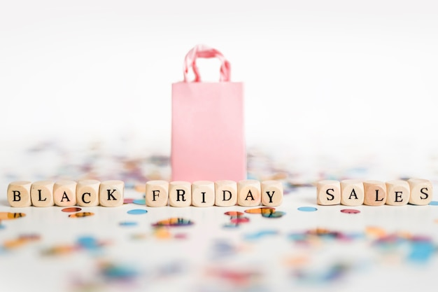 Black friday sales inscription on cubes with shopping bag