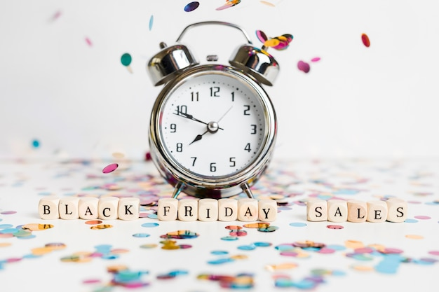 Black friday sales inscription on small cubes with clock