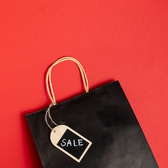 Black friday sales paper bag on red background