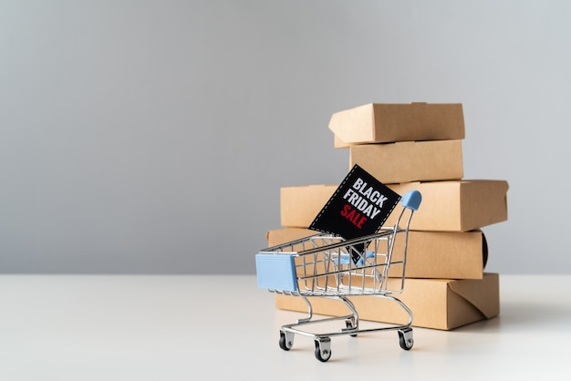 Black friday shopping cart in front of boxes
