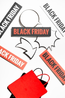 Black friday signs with conversation clouds and shopping bags