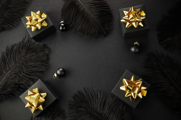 Black friday super sale background. black gift boxes with golden ribbons