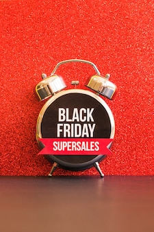 Black friday super sales inscription on alarm clock