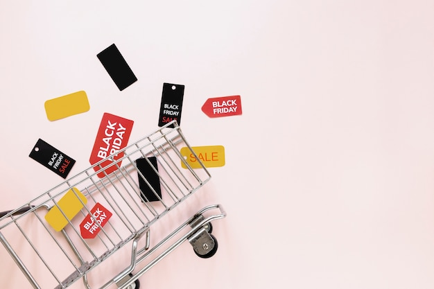 Black friday tags and stickers near shopping cart