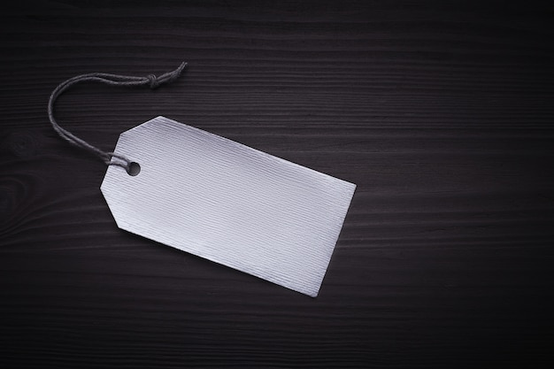 Black friday text on a black tag on black paper