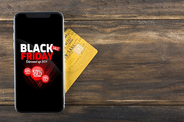 Black friday text on screen of phone on table