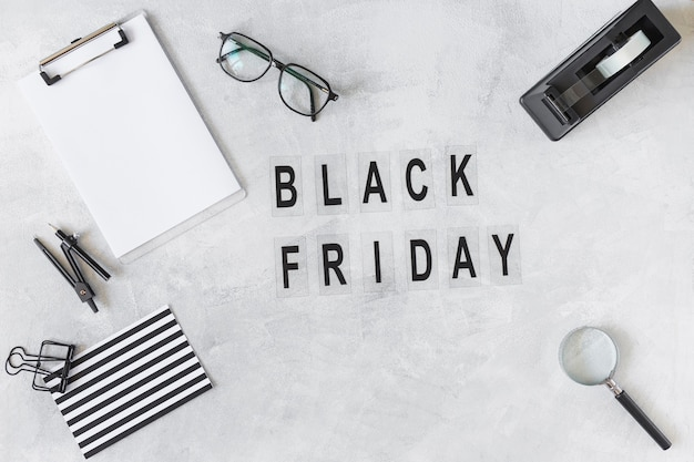 Black friday title near different stationery