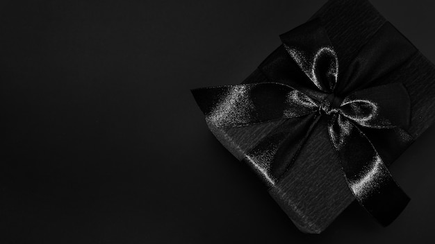 Black gift on dark background