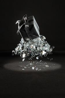 Black gift with confetti arrangement