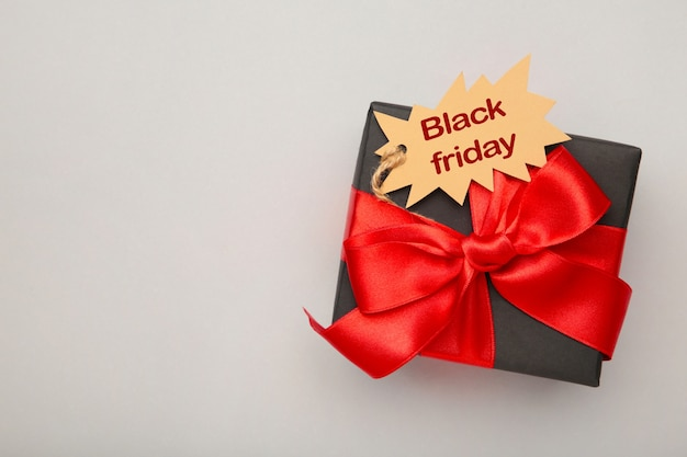 Black gift with sale tag top view