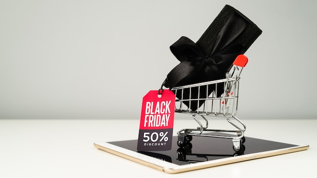Black gift with tag in shopping cart