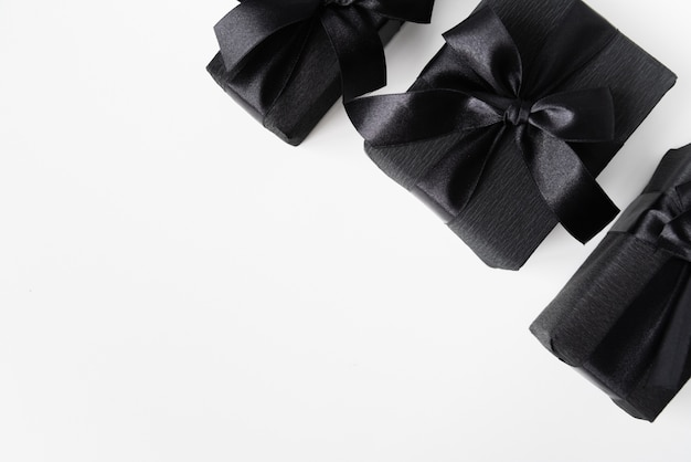 Black gifts on plain background