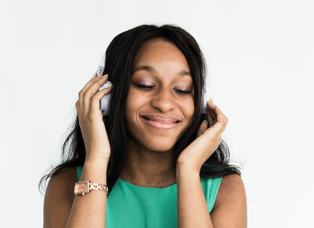 Black girl cheerfully listening to music