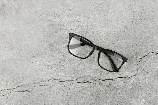 Black glasses on concrete background. two pairs of 3d glasses on a gray concrete background. top view, copy space. two pairs of 3d glasses on a gray concrete background. top view, copy space