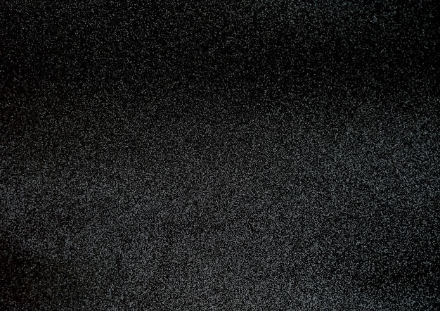 Black glitter texture surface background.