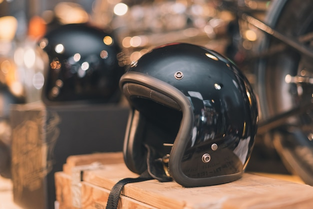 Black glossy vintage helmet place on the wooden box