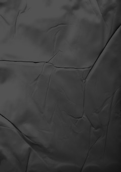Black glue wrinkled and crumpled paper texture