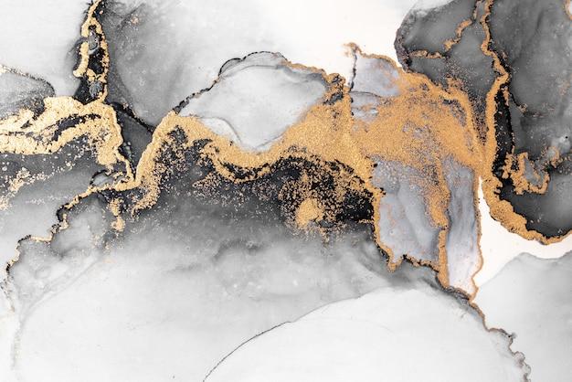 黑色金色抽象背景的大理石水墨艺术画在纸上。