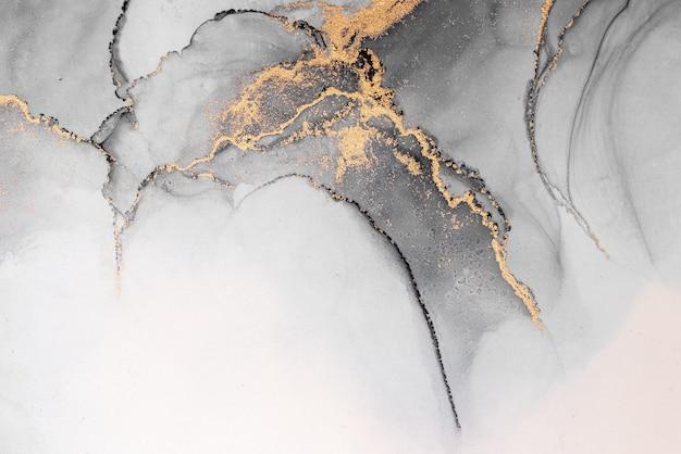 종이에 대리석 액체 잉크 아트 페인팅의 블랙 골드 추상적인 배경.