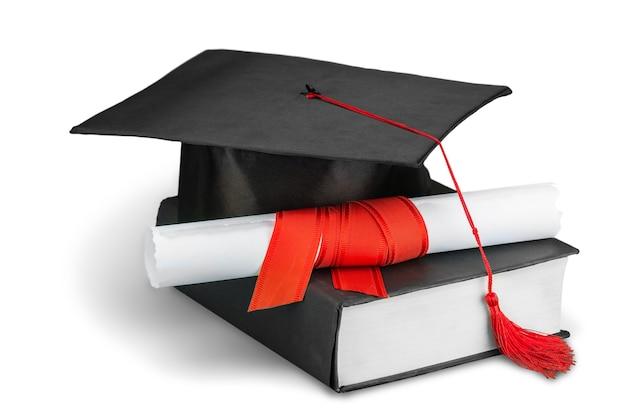 白い背景で隔離の程度と黒の卒業帽。