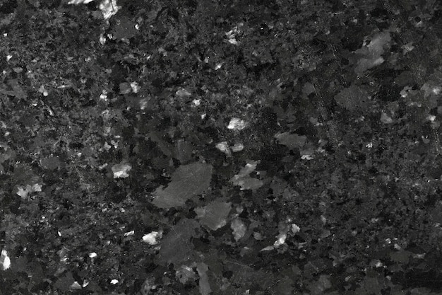 Black granite texture close-up. high resolution photo.