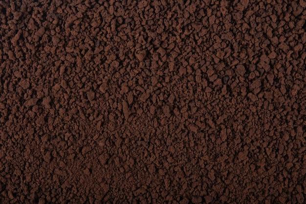 Черная текстура гранулированного кофе.