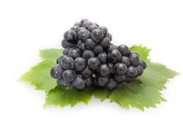 Black grapes bunch isolated on white background with green leaf package design element