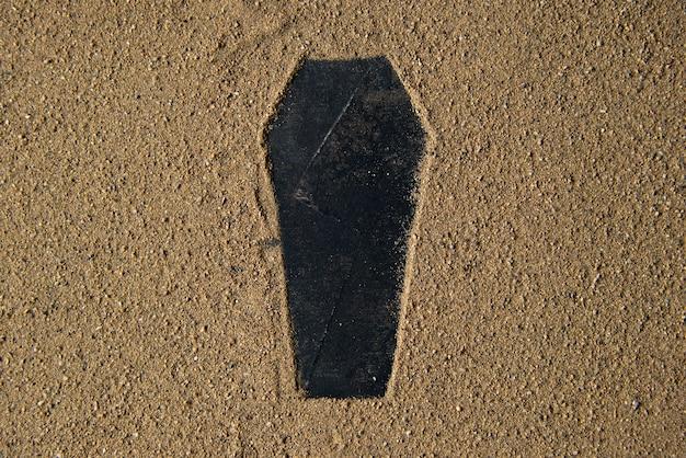 Black grave shape made on the sand