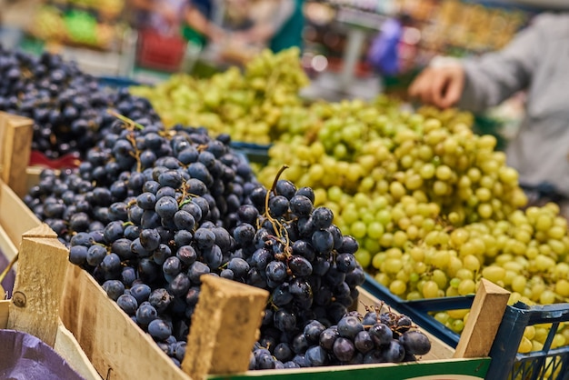 Black and green grapes in the store