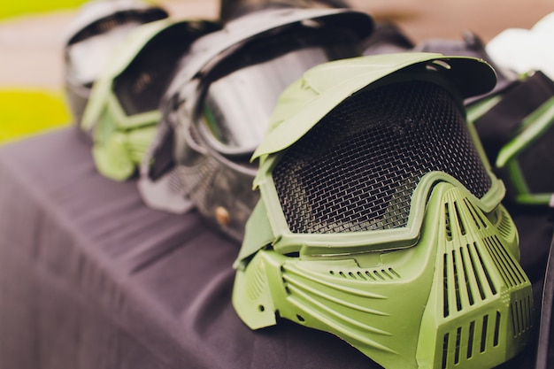 Black and green paintball helmet. mask, a helmet for a game in a paintball.