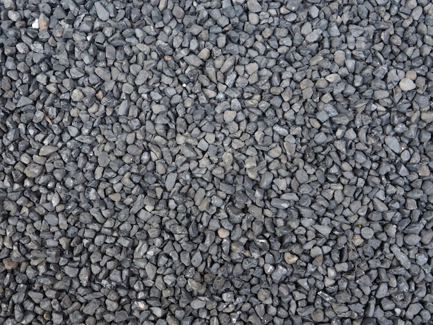 Black, grey stone gravel closeup texture.