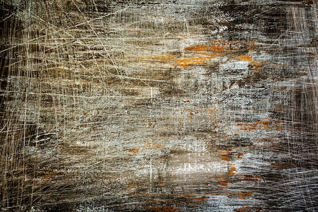 Black grunge background with white scratches