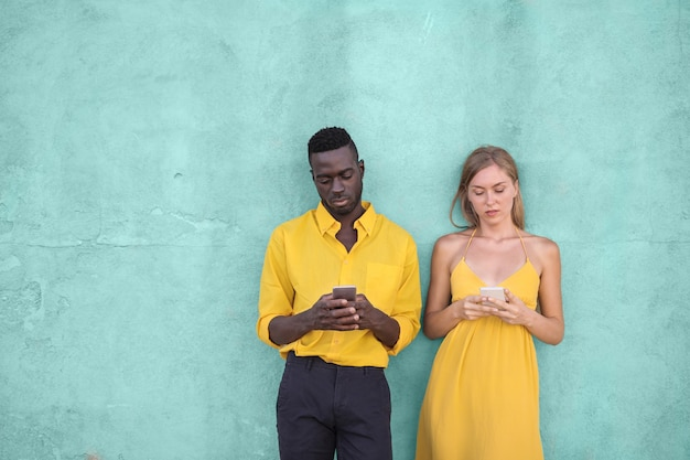 Black guy and a blonde woman texting