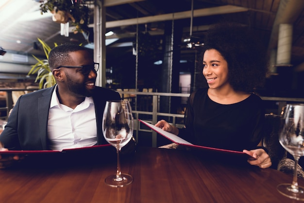 Black guy and the girl came to the restaurant.