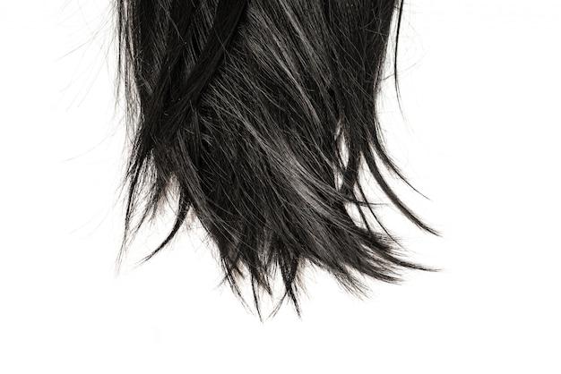 Подсказки черных волос изолированные на белизне.
