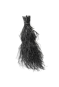 Black halloween witchs broom on a white background