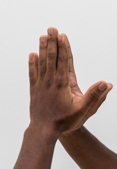 Black hands coming together in pleading