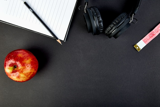 Black headphones and apple