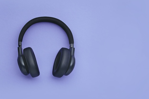 Black headphones on a colored background
