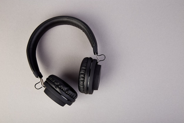 Black headphones, flatl lay