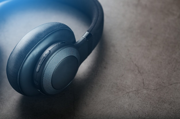 Black headphones on grey