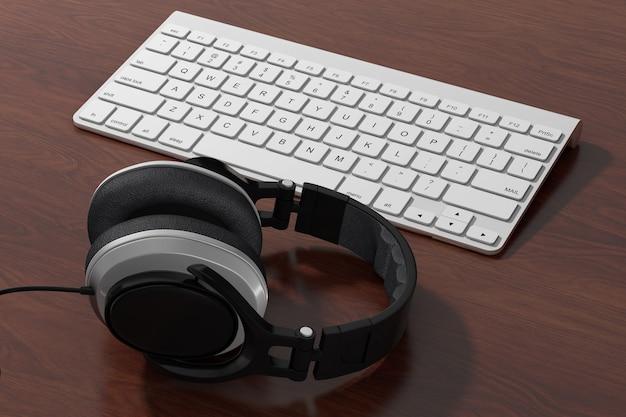 나무 테이블에 흰색 컴퓨터 키보드가 있는 검은색 헤드폰. 3d 렌더링