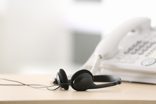 Black headset on table of technical support agent in office